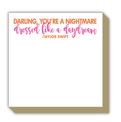 "notepad of 100 sheets of 4"" x 4"" paper with gold edges that reads ""Darling you're a nightmare, dressed like a daydream"""