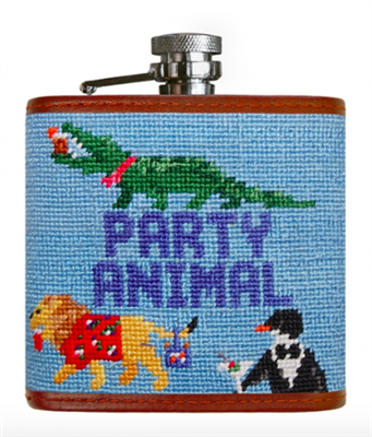 light blue needlepoint flask with party animals on it