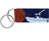 Blue needlepoint key fob with a power boat on the front and back