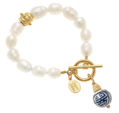Ladies white freshwater pearl bracelet with hand painted blue and white porcelain ball