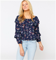 navy floral top with flowers and ruffle details