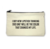 cream Canvas Pouch with top zipper that reads I Buy New Lipstick Thinking This One Will Be The Color That  Changes my life""