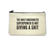 cream Canvas Pouch with top zip that reads, the most underrated super power is not giving a shit