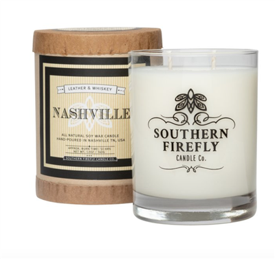 14 oz glass candle that smells like leather and whisky