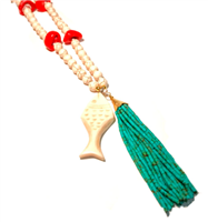 long white howlite beaded necklace with coral details and a cream fish with green tassel
