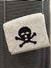 ladies white beaded bag with black Jolly Roger