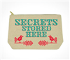 "fabric pouch with top zip that says ""Secrets Store Here"""