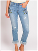 slightly distressed cropped jeans with fringe hem and embroidery