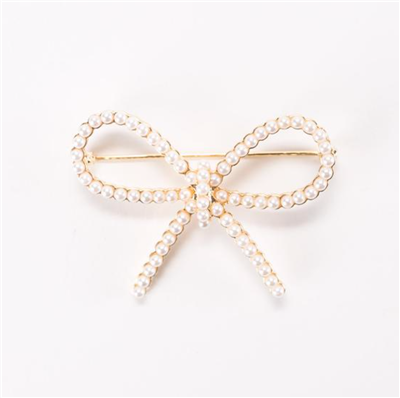 Ladies faux pearl bow pin in gold