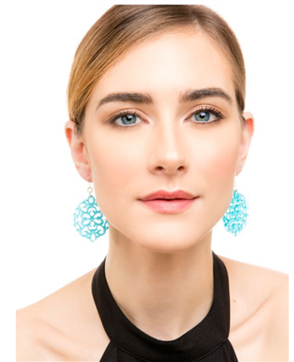 Ladies bright blue resin earrings in round cutout shape on wire.