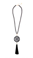 31.5 inch beaded necklace with black resin cutout pendant with black tassel gold hardware