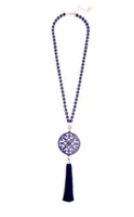 31.5 inch beaded necklace with navy resin cutout pendant with navy tassel gold hardware