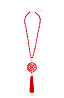 31.5 inch beaded necklace with red resin cutout pendant with red tassel gold hardware