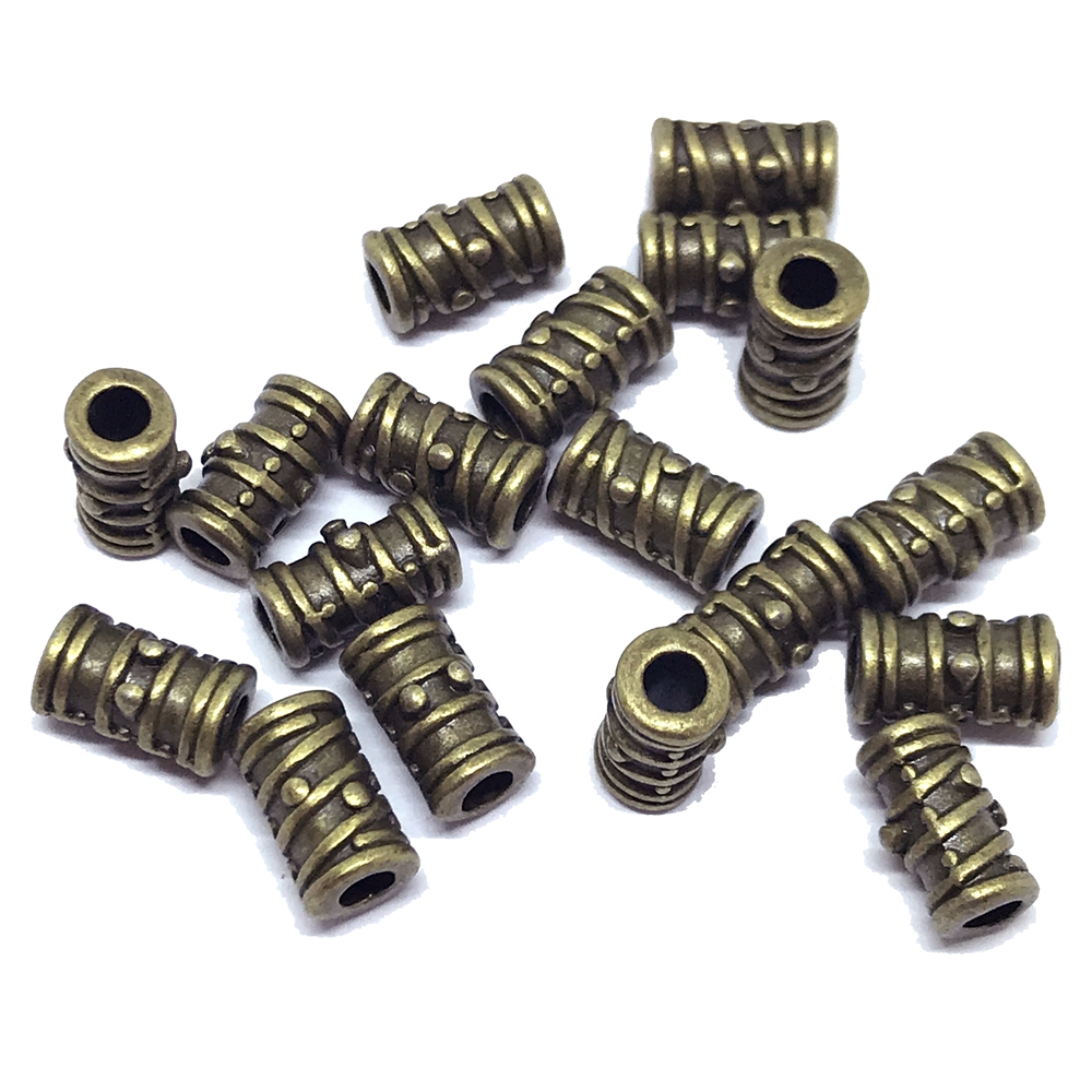 brass beads, industrial beads, antique brass, 01295, b'sue boutiques, nickel free, us made, jewelry supplies, jewelry making, brass jewelry parts, steampunk, vintage supplies, vintage jewelry supplies, textured beads, bead, brass, 9 x 5mm
