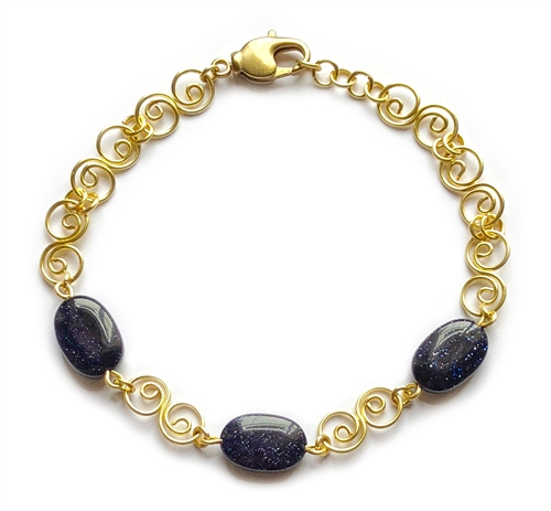blue goldstone wire bracelet, handmade, wire design, bracelet, gold, gold bracelet, semi precious beads, wire bracelet design, blue goldstone bracelet, swirl lobster clasp, spiral links, Javi's Wire, goldstone, wire,nickel free, glass beads,7.5 inches,010