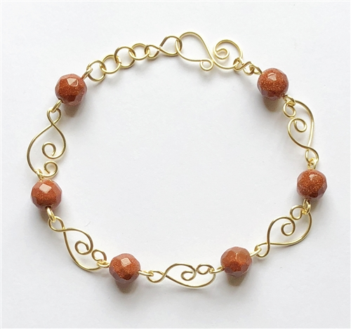 brown goldstone wire bracelet, handmade, wire design, bracelet, gold, gold bracelet, semi precious beads, wire bracelet design, brown goldstone bracelet, spiral wire clasp, design links, Javi's Wire, goldstone, wire, nickel free, glass beads,7.5 inches,09