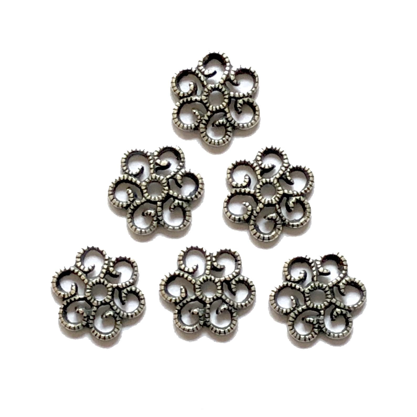 brass flower stamping, silverware, open flower stamping, 08350, antique silver, black antiquing, silverware silverplate, bracelet charms, US made, nickel free, bsueboutiques, jewelry making supplies, vintage jewelry supplies