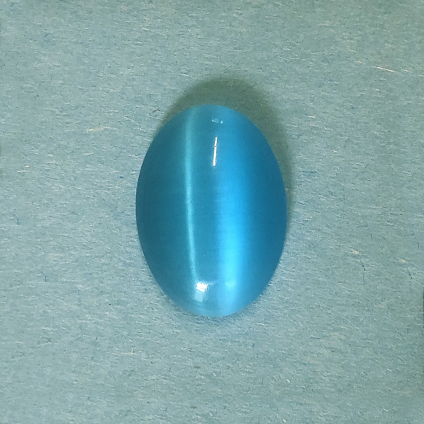 aqua cat's eye stone, focal stone, fiber optic, glass stone, glass, cat's eye, aqua stone, cabochon, transparent, oval, glossy shine, oval stone, US made, B'sue Boutiques, jewelry stone, 25x18mm, 09704