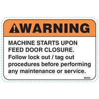 DECAL MACHINE STARTS UPON FEED DOOR CLOSURE, LOCKOUT/TAGOUT