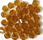10pc Faceted Crystal Twist Rounds Topaz 8mm