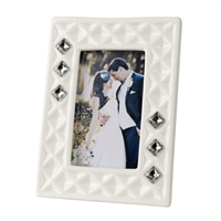 Diamond pockets, some filled with Swarovski crystals, border the picture slot in this Debra Carlucci vogue line picture frame imported from Italy.   This elegant frame would make a great gift for wedding party or other occasions.  Capture precious memori