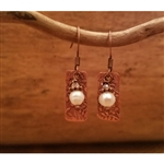 Down To Earth Copper flower dangle earrings with a sweet pearl