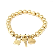 Gold Beaded Stretch Bracelet with Gold Locket, Key, and Heart Charms