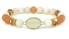 Cream and Peach beaded  stretch bracelet with accent stone
