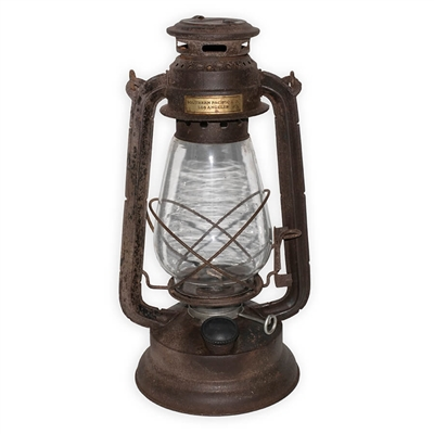 Metal Railroad Lantern with antique finish and brass Southern Pacific Railroad tag. Excellent as a set piece or for home decoration.