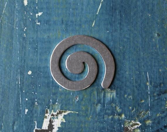 Spiral 18 Gauge Deburred Metal Stamping Blank