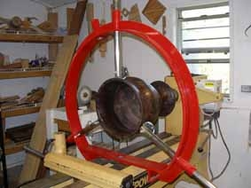"Clark Steady Rest -18"" Flat Base with 3 arms and extra 1 o'clock arm position in red shown in use with a large walnut project just hollowed."