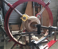 "Clark Steady Rest -25"" Flat Base configuration shown mounted on a lathe with project in position.  This one is red color."