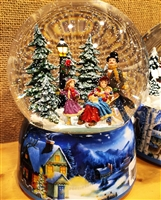 MUSICBOX KINGDOM SNOW GLOBE SLEDGE AND SKATERS