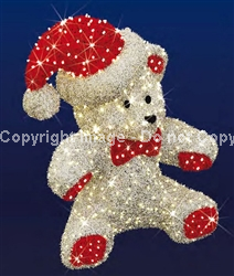 teddy bear with carpet garland and Santa hat
