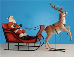 fiberglass sleigh with Santa and Reindeer