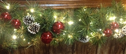 Mountain Pine garland with accents with ball clusters, lights and pine cones