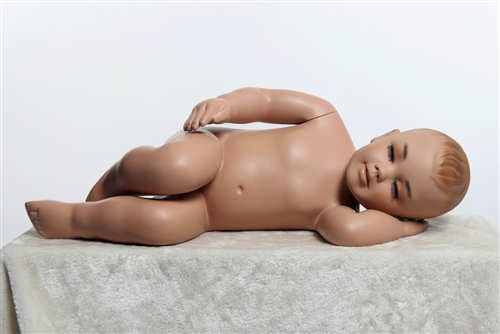 Sleeping toddler mannequin. Unisex toddler with realistic facial features.
