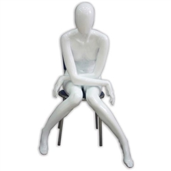 Glossy White or Glossy Black Female Mannequin in Seated Pose with arms crossed, knees together from www.zingdisplay.com