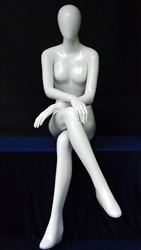 Glossy White Female Egghead in Sitting Pose from www.zingdisplay.com