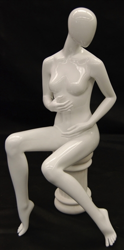 Female Egghead Mannequin in Seated Pose.  She has an abstract head.