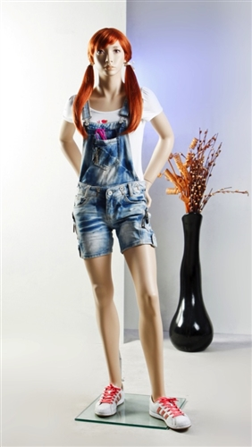 Female teenage mannequin with realistic facial features.  Her hands are on her hip in a sassy pose.