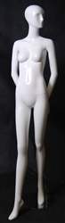 Glossy White Female Mannequin with Abstract Head in a Demure Pose with her Arms Behind her Back