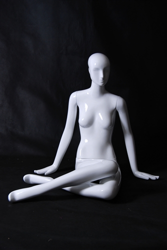 Glossy White Female Mannequin in Seated Pose from www.zingdisplay.com