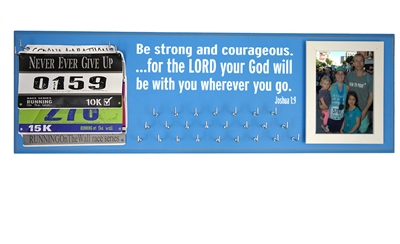 Inspirational running quotes on race medals display rack - Joshua 1:9