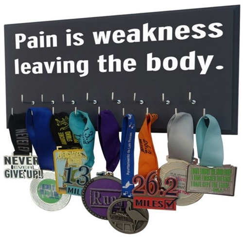 Running quotes on medals holder - Pain is weekness leaving the body