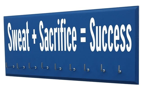 Motivational running quotes on medals holder - Sweat and sacrifice equal success