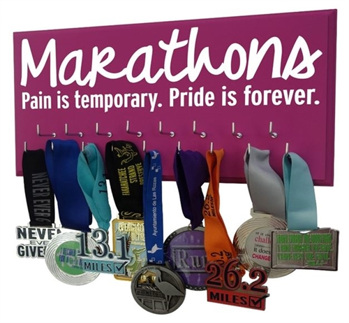 Marathon medals display with inspiring quotes