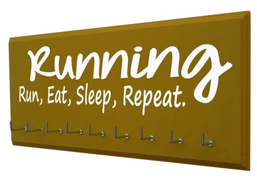 motivational Running quotes on medals hanger