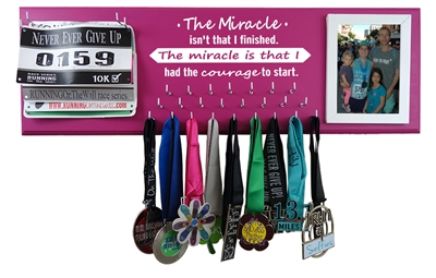 The miracle is that i start - running medals holder