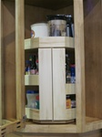 Upper corner cabinet rotating pullout